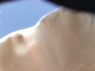Beautiful ass in dark skirt is filmed in upskirt mode