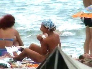 Buxom nude beach babes flaunt their jugs before a hidden camera