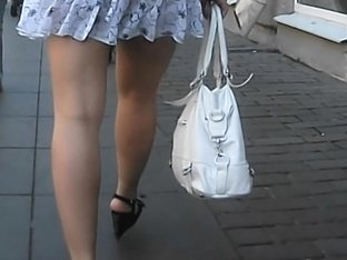 Charming brunette with sexy butt walking on the streets