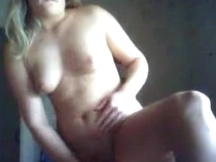 Nerdy glassed blonde girl masturbates her shaved pussy standup with a vibrator in her bedroom