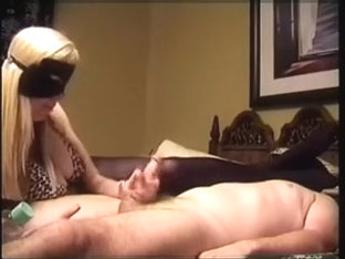 Golden-Haired slut in mask jerks off her boy's ding-strapon in bedroom