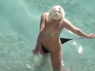 Drunk slut strips her bikini in the water