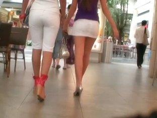 Two amazing brunette fine ass sluts in a shopping mall voyeur upskirt