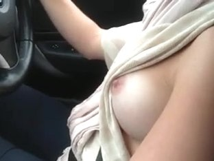 My slutty busty wifey loves to drive a car flashing her tits