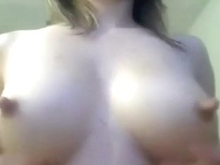 Brunette latina squeezes her tits and squirts milk on cam