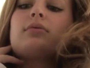 Danielle licks her own nipps