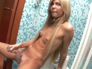 Petite Blonde Gets Playfully Erotic In The Shower