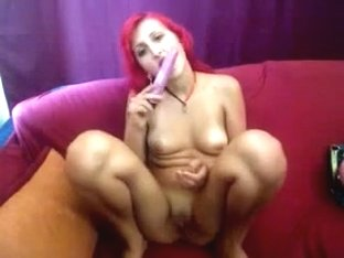 Slim redhead with sex-toy