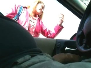 Hand job throughout the car window