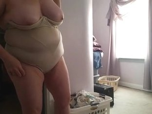 bbw wife squeezing into tight girdle, big tits