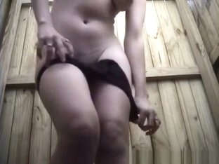 Woman changing in beach cabin