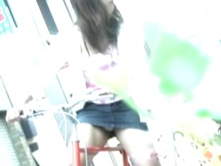 Pretty amateur girl in short skirt riding bicycle