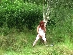 Non-Professional Redhead Makes Water And Masturbates Outdoors