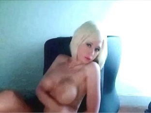 Big tit blonde puts on a nude show