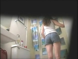 Cute girl stripping for shower