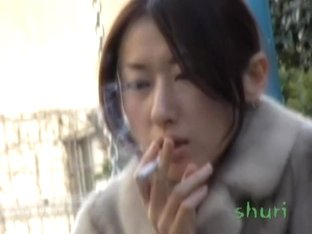 Leggy oriental tramp smoking some cigarette during wild sharking attack
