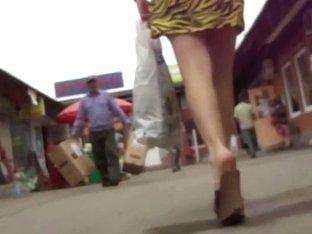 Voyeur upskirt pono video of a hot white lady in yellow/black dress.