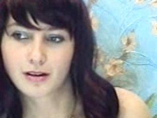 Brunette girl stripping and masturbating for the internet
