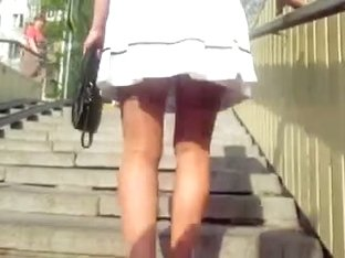 White skirt and tan stockings uptairs