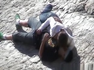 Girl masturbates her guy in the rocks