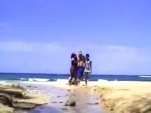A lucky man on the beach with two ebony nymphs