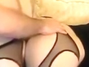 Couple in fetish stockings doggy sex