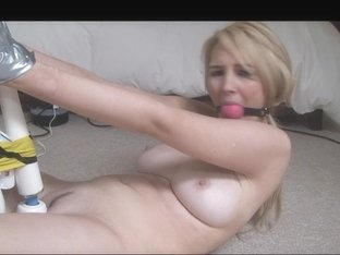 Blonde Katie is tied up and her bun gets wet from dildo
