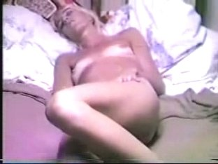 Tanned gal plays with nub