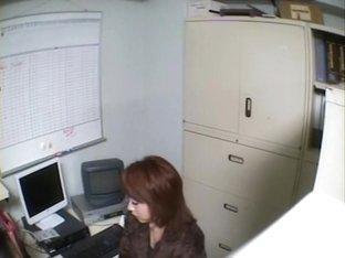 Naughty Jap sucks of her boss in voyeur office sex video