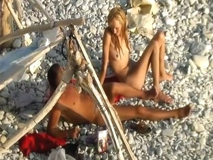 Horny couple spied on a beach