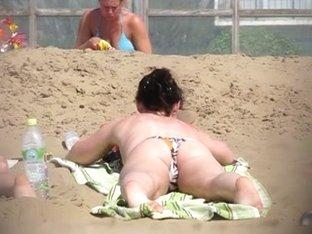 Topless beach brunette part1