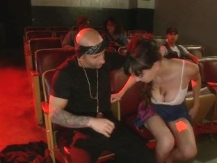 Slinky slut gives it up in an adult movie theater
