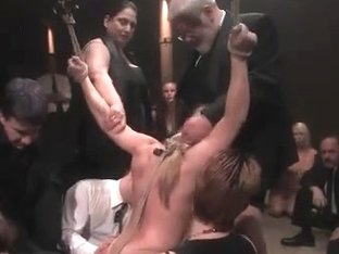 Busty blonde enjoys a kinky BDSM game with toys