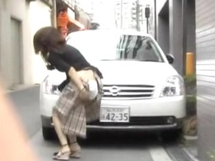 Great Asian hottie getting nicely spanked in the public place