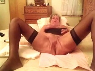 Blonde granny plays with her shaved pussy
