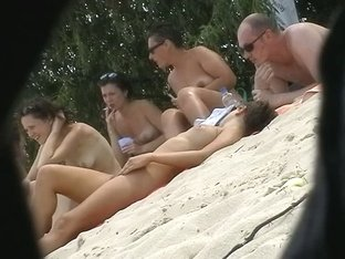 four naked beauties on the beach mucking about bollock naked