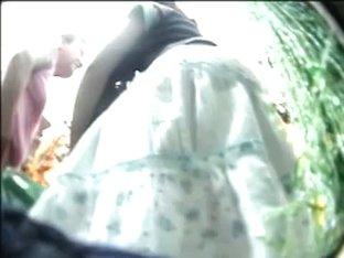 green and white flowery mini skirt upskirt in slow motion
