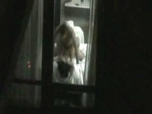 Couple caught fucking through hotel window