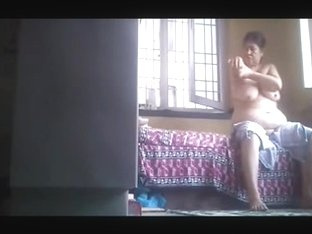 Big Tit Indian Aunty Rubs on Lotion in Open Window