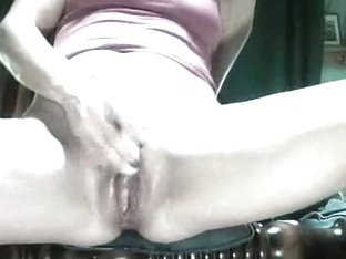 Pale woman toys her shaved pussy and gets it on camera