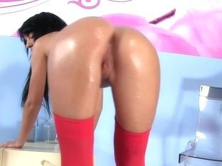 Adorable teen in stockings plays with her wet crack