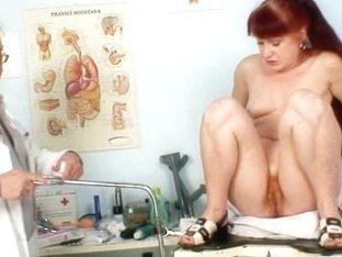 Mature Olga has her redhead pussy gyno speculum examined
