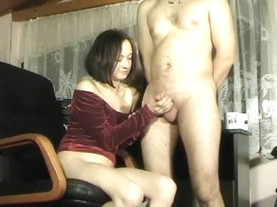 velvet dressed woman giving naked amateur dude receiving a h