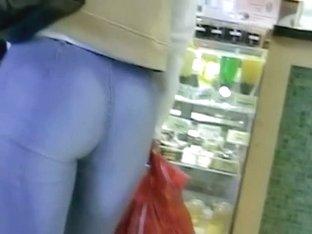 Non-nude street voyeur video of a terrific ass going shopping