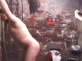 Cute oriental femdom-goddess whips sex thrall in slavery basement