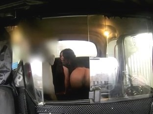 Interracial sex scene in a fake cab with a busty Ebony