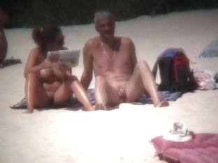 Lazy nudists being filmed by a hidden camera on the coast