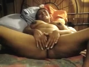 A EXTRA HORNY BLACK MILF RUBBING ALL OVER PUSSY AND TITTIES
