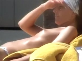 Spying on sultry Spanish darksome brown tanning her body topless