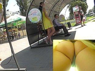 Pretty yellow dress and sexy upskirt thong panties